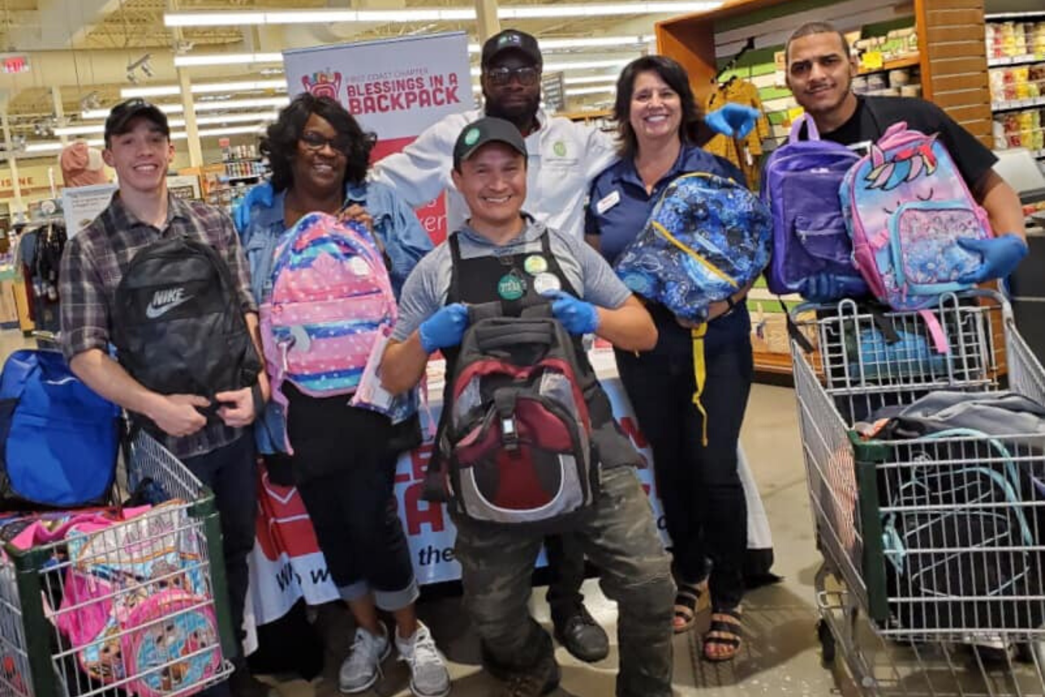 Photo of people holding back packs