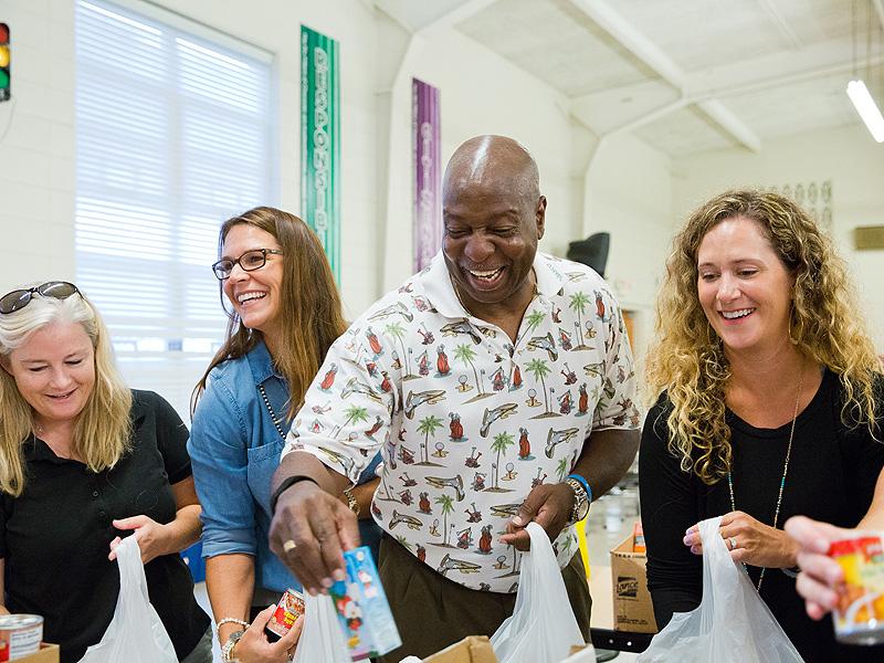 Mayor Harvey packing bags of food