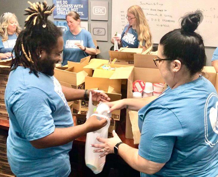 Regency employees packing bags of food