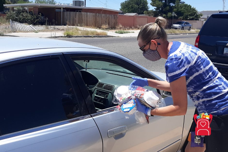 volunteer distributing food during COVID